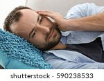 handsome man suffering from... | Shutterstock . vector #590238533