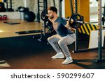 handsome man doing squats with... | Shutterstock . vector #590299607