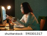 business lady checking her... | Shutterstock . vector #590301317