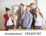 Small photo of Group of beautiful cheerful young people in office talking on their phones all at once. Communication concept
