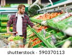 handsome man with shopping... | Shutterstock . vector #590370113