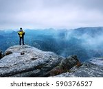 rear view of male hiker in... | Shutterstock . vector #590376527