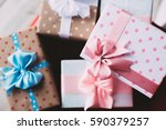 many gift boxes top view. | Shutterstock . vector #590379257