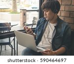 a man using smart phone and... | Shutterstock . vector #590464697