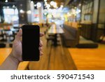 man holding smartphone with... | Shutterstock . vector #590471543