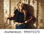 street style. beautiful woman... | Shutterstock . vector #590472173
