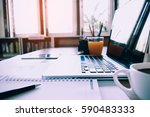 laptop with financial documents ...   Shutterstock . vector #590483333
