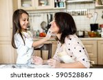mother and daughter cooking | Shutterstock . vector #590528867