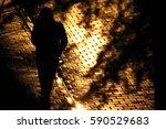 Shadow. Man Walking At Night.