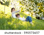 little girls sisters hug around ... | Shutterstock . vector #590573657