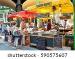 Small photo of LONDON, ENGLAND, UK - JUNE 6, 2013: Specialty food stalls at Borough Market in London