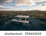 Small photo of pic nic table in a rest area watching over a flat mossy plain in Iceland