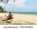 girl on the beach alone ... | Shutterstock . vector #590704007
