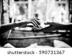 touching hands of spouses.... | Shutterstock . vector #590731367