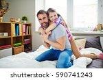 cute little girl embracing her... | Shutterstock . vector #590741243