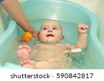 funny little baby lying in the... | Shutterstock . vector #590842817