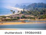tropical beach in goa on a... | Shutterstock . vector #590864483