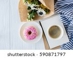 coffe and a donut with fresh... | Shutterstock . vector #590871797