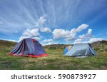 summer landscape with tents on... | Shutterstock . vector #590873927
