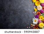 garden flowers over stone table ... | Shutterstock . vector #590943887