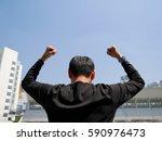 a man standing outdoor  feeling ... | Shutterstock . vector #590976473
