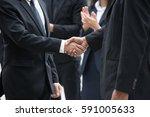 businessmen handshaking after... | Shutterstock . vector #591005633
