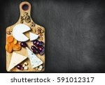 assorted cheeses  nuts and... | Shutterstock . vector #591012317