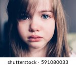 sad offended girl  cries | Shutterstock . vector #591080033
