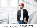 engineer in hardhat with laptop ... | Shutterstock . vector #591099377