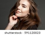 Small photo of Pretty young happy smiling girl with flying hair looking at the camera.
