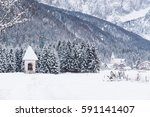 snowy landscapes. valbruna and... | Shutterstock . vector #591141407