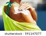 Woman Applying Sunscreen On He...