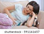 beautiful young woman suffering ... | Shutterstock . vector #591161657