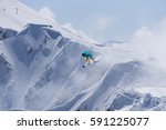 flying snowboarder on mountains | Shutterstock . vector #591225077