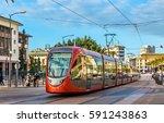 City Tram On A Street Of...