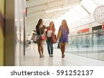 friends shopping together.... | Shutterstock . vector #591252137