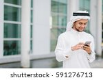 young arab businessman using... | Shutterstock . vector #591276713