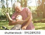 senior man with granddaughter... | Shutterstock . vector #591289253