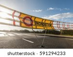 flood warning signage on a road ... | Shutterstock . vector #591294233