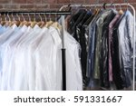 rack of clean clothes hanging... | Shutterstock . vector #591331667