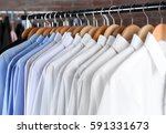 rack of clean clothes hanging... | Shutterstock . vector #591331673
