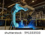 robot welding automotive part  | Shutterstock . vector #591333533