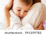 dreamy little boy hugs his... | Shutterstock . vector #591359783
