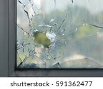 hole in the window glass by a...   Shutterstock . vector #591362477