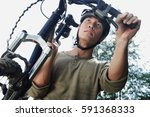 man carrying bicycle  low angle ... | Shutterstock . vector #591368333