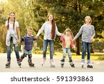 cheerful children on roller... | Shutterstock . vector #591393863