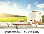 easter breakfast table in the... | Shutterstock . vector #591461387