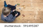 young boy playing with... | Shutterstock . vector #591495287