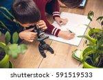 closeup of little boy using... | Shutterstock . vector #591519533