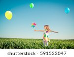 happy child outdoors against... | Shutterstock . vector #591522047
